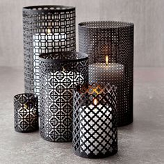 Crafted for fall but perfect year round.  Love this for centerpieces, even lining an aisle | Aluminum Candleholders Flickering candlelight is perfect for sharing ghost stories. We used sheets of decorative aluminum to cast spooky sh...