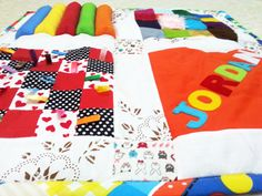 Colorful Personalized Baby Play Mat - Tummy Time Play Mat - Sensory Taggie Baby Play Mat ...maybe I can try making my own!
