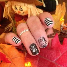 Cute Halloween Nails! Jamberry's Dem Bones and Black and White Stripe. Shop at https://cuteclassyjams.jamberry.com/shop. Photo from katieeisenberg on IG