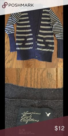 AE Blue/Gray Button cardigan Sz Large. Nice! Nice Blue/Gray American Eagle Cardigan size large. Medium weight with ribbed sleeves and hem. Used but nice condition. Unable to find any stains or fraying. Front & sleeves have stripe, back is solid Blue. American Eagle Outfitters Sweaters Cardigans