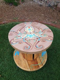 I hand painted all my tables this is the octopus table. To see more of my tables you can check out my Facebook at Cindy's Art https://www.facebook.com/pages/Cindys-Art/266776950041155?ref=hl