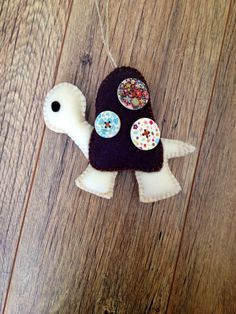 Hanging felt tortoise ornament with button detail