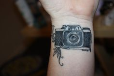 Daisy Camera Tattoo On Wrist