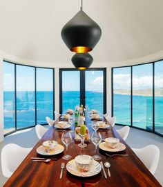 Guanacaste dining table with a view.  Gwel an Treth, luxury self catering in Sennen Cove. Designer holiday home in West Cornwall.