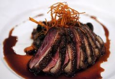 Seared Liberty duck breast, duck and sweet potato hash, star anise port sauce. Beautifully cooked, the duck breast is juicy and tasty. Served with tender pieces of the bird's dark meat and a rich, flavorful sauce. (Baker and Banker)