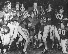 Players lift Coach Munn at the Rose Bowl, 1954 by Michigan State University Archives, via Flickr