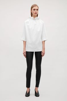 COS image 4 of Slim-fit leather trousers in Black