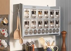 The first product to be created was the 12-scoop Kitchen Storage Cabinet; a replica of the original cabinet left to her by her grandmother, which she had seen and used in childhood at her home in Oslo.    It is a charming piece of kitchen furniture – a spice and dry food storage cabinet, that is space saving, simple, convenient and fun to use, as well as child friendly and mouse proof!