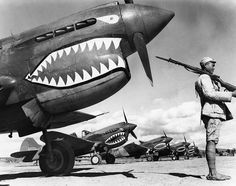 "Historical Pix  (@historicalpix) on Instagram: ""c. 1942. A Chinese soldier guards a line of American P-40 fighter planes, painted with the shark-…"""