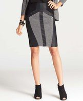 """Crosstown Colorblock Skirt - Daringly designed for day to night style, our elongated skirt merges tailored tweed with sleek faux leather for a mix of uptown elegance and downtown attitude. Hidden back zipper with hook-and-eye closure. Back vent. Lined. 22"""" long."""