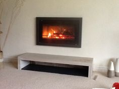 Hagley Stoves fitted this Stovax Riva Studio 1 and Profil frame with a natural stone 'bench' and slate base below