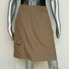 Adventurous Outdoor Cargo Tan Skirt by Sahalie Brand Sahalie Size 10 Designer is known for Adventurous Outdoor styles. Cargo style skirt with button zipper side, cargo velcro flap hem pocket with netted inside, elastic hook for locker keys etc inside waistband Perfect for Tennis shoes to sandals 100% Polyester so comfy you won't want to take it off. Perfect condition  Ready to go from my house to yours Bundles available with discounts Sahalie Skirts Pencil