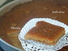 Recette le Kalb el louz     Ingredients :  pour un moule rond de 40 cm  -1kg de grosse semoule ( blé dur) on peut utilisé la moyenne mais...