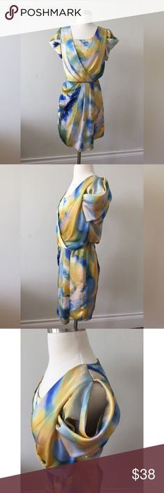 """Vince Camuto Draped Tulip Dress,Cold Shoulder This beauty is just like an art work! It comes with faux wrap, makes the skirt looks like tulip. a blue and yellow tie dye pattern with open shoulder effect. Perfect for wedding, party, or special events.   • Rear zipper closure •Invisible elastic waistband at back • Faux wrap • Fully lined • Bust :34"""" • Waist: 28"""" • Hip:38"""" • Sleeve length: 5.5"""" • Length :32"""" • Condition: Excellent. Like new. All photos used in listings are of the actual item…"""
