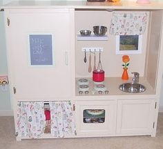 Repurposed entertainment center---play kitchen WOW I Could totally do this with my moms but I dont have the space :(