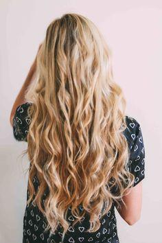 Long blonde hair. Curly hair.
