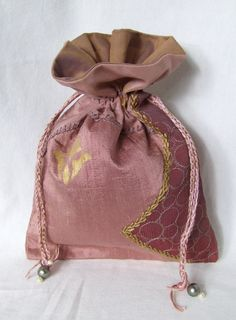 Lavender Pink DRAWSTRING GIFT BAG of silk and poly sari pieces, hand stenciled, with braided twisted drawstring cords, wood bead tassels by TheNomadsNeedle on Etsy