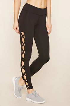 7832727083f9 A pair of stretch knit athletic leggings with crisscross-cutout sides