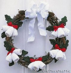 Wreath of grapevine and pinecones, with crocheted bells and leaves | broken link