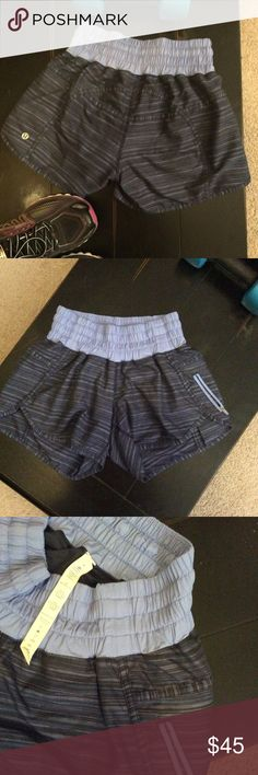 Lululemon Run Shorts Bluish/Purple band with multicolored strip on body of shorts as pictured. Key pocket.  Barely worn.  Size 4.  Open to reasonable offers lululemon athletica Shorts