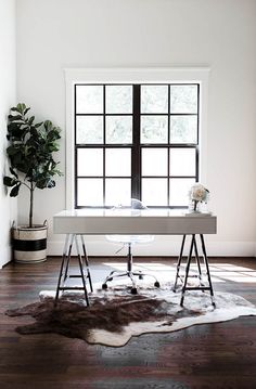Black and white home office design. Modern industrial desk home office. Animal hide rug office.