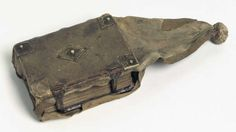 "Girdle Book. The Law of Jutland. Denmark c. 1490.Rostgaard 6 8º. Parchment, 135 fols. 13 x 9.6 cm. Binding is c. 30 cm long. Book has an extended covering of soft leather. Girdle books were books bound with a flexible cover ""tail"" that could be tucked into one's girdle/belt for ease of carrying. This left the book hanging upside down; when wearer wanted to read the book, they picked it up & opened it. When book was being read from a table/lectern, the tail would have draped down off the…"