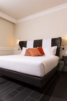 You'll find ebony flooring, burnt orange couches and stark white linens in the rooms. #Jetsetter