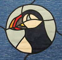 Stained glass puffin.
