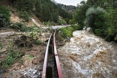 washington flooding | Boulder Creek flows at high speed next to a road closed off by debris ...