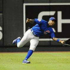 PHOENIX, AZ - JUNE 23: Alfonzo Soriano #12 of the Chicago Cubs makes a running catch against the Arizona Diamondbacks at Chase Field on June 23, 2012 in Phoenix, Arizona. (Photo by Norm Hall/Getty Images)