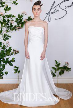 "Brides.com: . ""Clairvoir"" silk, satin, and organza column wedding dress with an asymmetrical neckline and detachable petal train, Austin Scarlett"