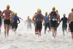 Group of athletes running into the water during the yearly Beach Challenge at Kijkduin; The Hague  (Photo courtesy: Den Haag Marketing).
