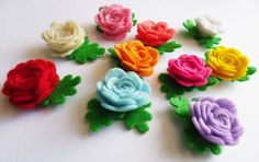This is a set of 10 felt flowers appliques. this cute appliques are ready to use them, can be sewn or glued The felt appliques are handmade, so the size can vary a bit in each flower These lovely felt applique are perfect for crafts, scrapbooking, cards, gift tags, headbands, hair