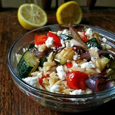 A Greek-inspired salad with caramelized, roasted zucchini, peppers, onions, and grape tomatoes.