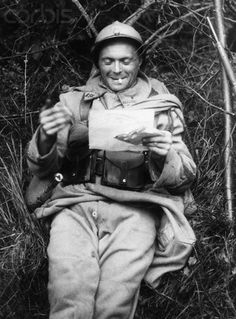 Original caption:French soldier receiving mail from home. World War I.