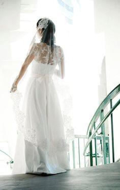 Brautkleid-mit-Brautfrisur-kombinieren-Schleier-als-modisches-Highlight
