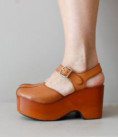platform shoes / 1970s wooden platforms / Platform Mary Janes. $225.00, via Etsy.