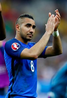Dimitri Payet Photos - Dimitri Payet of France applauds supporters after his team's 2-1 win in the UEFA Euro 2016 Group A match between France and Romania at Stade de France on June 10, 2016 in Paris, France - France v Romania - Group A: UEFA Euro 2016