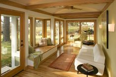 Four seasons room or also called as sunroom, or winter room, or solarium and many more names are built in the house or office where people can enjoy the surrounding view while being covered by the weather. Having a four-season room can be expensive Four Seasons Room, 4 Season Room, Modern Family Rooms, Sunroom Addition, Family Room Addition, Room Additions, Family Room Design, Space Architecture, Home Decor Bedroom