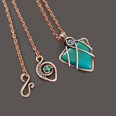 Unique copper wire jewelry - a beautiful green onyx pendant. This triangle pendant is entirely handcrafted, shaped by hand. This gorgeous green stone is secured in the wire with the unique technique of wire wrapping. The small bead is a 4mm azurite stone. The clasp of this handmade
