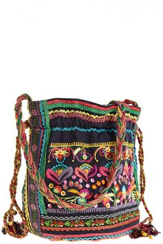 Whimsical embroidery, plastic beading and sequins make this small pouch festively colorful. @Kristen Kyslinger St. Barth