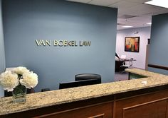 Brushed Brass Letters. This office combines the rich warmth and tradition of our satin brass letters and a fine wood reception desk yet still has a modern feel - professional and dignified but not stuffy. Courtesy: Van Boekel Law Firm, LLC East Hanover, NJ. www.cut-metal-letters.com