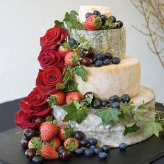 Now that I know that this exists - a wedding cake made of wheels of cheese - I may not be able to think about anything else.