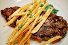 French sirloin steak medium with fries very much like the entree at Le Picotin mentioned in Fifty Shades Darker page 19
