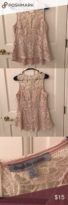 NWOT..Charlotte Russe beige lace high low top Very pretty beige lace top. High low design. Back hangs a little lower than the front. Zipper in the back. NWOT. Size XL Charlotte Russe Tops Tank Tops
