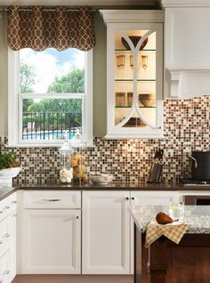 Seriously:  peel and stick wall tile. Kit comes complete with grout. Do a backsplash in 2 hours!