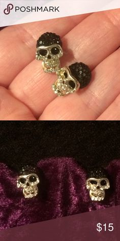 Rhinestone Encrusted Skull Stud Earrings These are absolutely gorgeous! I always get compliments. When I wear my personal pair. Silver with clear and black rhinestone Embellishments. skull Jewelry Earrings