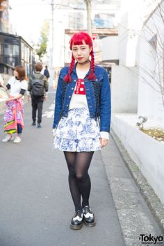 Always-friendly Hiromi from Nadia Harajuku on the street wearing a Kiko Mizuhara x Opening Ceremony denim jacket over a Unif sweater, Jeremy Scott skirt, and Dr. Martens. Full Look
