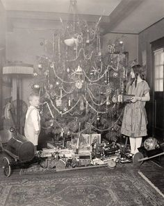 Early 1900's photo of children & Christmas tree.