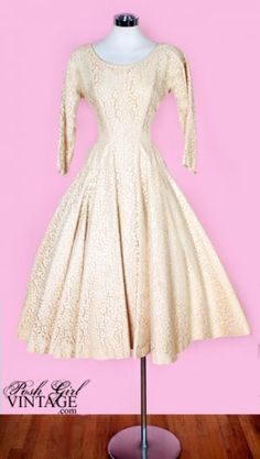 """$499 """"Here's an amazing and hard to find dress from the 50's...a classic tea length... light pale neutral beige lace over matching taffeta... This would make a perfect vintage wedding dress or party gown! Metal zipper in back, dropped waist seam for a flattering fit, dolman cut sleeves, very full skirt, bust has darts, amazing condition! Add a ribbon around waist in a pretty accent color or leave it simple. It's much too big for our mannequin so the fit in the pics is not the best. It's a…"""